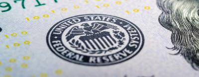 Federal reserve system symbol on hundred dollar bill closeup macro shot